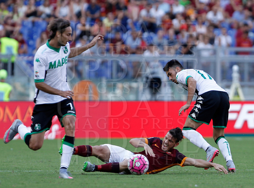 Calcio, Serie A: Roma vs Sassuolo. Roma, stadio Olimpico, 20 settembre 2015.<br /> Roma's Alessandro Florenzi, center, is fouled by Sassuolo's Nicola Sansone, right, during the Italian Serie A football match between Roma and Sassuolo at Rome's Olympic stadium, 20 September 2015. At left, Simone Missiroli.<br /> UPDATE IMAGES PRESS/Isabella Bonotto