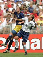Sara Larsson, left, Tiffany Milbrett, right, 2003 WWC USA Sweden.