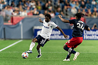 FOXBOROUGH, MA - AUGUST 18: Chris Odoi-Atsem #3 of D.C. United passes the ball as DeJuan Jones #24 of New England Revolution closes during a game between D.C. United and New England Revolution at Gillette Stadium on August 18, 2021 in Foxborough, Massachusetts.
