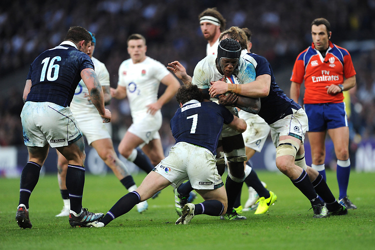 Maro Itoje of England is tackled by Hamish Watson and John Barclay of Scotland during the RBS 6 Nations match between England and Scotland at Twickenham Stadium on Saturday 11th March 2017 (Photo by Rob Munro/Stewart Communications)