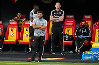 Watford caretaker manager Hayden Mullins and Watford head of goalkeeping Graham Stack look on during the Premier League match between Watford and Manchester City at Vicarage Road, Watford, England on 21 July 2020. Football Stadiums around remain empty due to the Covid-19 Pandemic as Government social distancing laws prohibit supporters inside venues resulting in all fixtures being played behind closed doors until further notice.<br /> Photo by Andy Rowland.