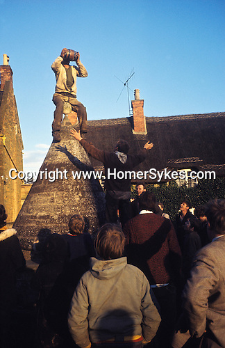 """Bottle Kicking and Hare Pie Scrambling, Hallaton, Leicestershire. Winner driking from one of the """"bottles"""" - beer barrel - at the end of the game from the top of the village Buttercross.  UK 1970s. 1971 or 1972.<br /> <br /> If you know the date and the names of anyone in this photo please make contact. Many thanks."""