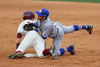 Scott Hood (19) dives to tag Tim Carver (18);March 10th, 2010; South Dakata State University vs Arkansas Razorbacks at Baum Stadium in Fayetteville Arkansas. Photo by: William Purnell/Four Seam Images