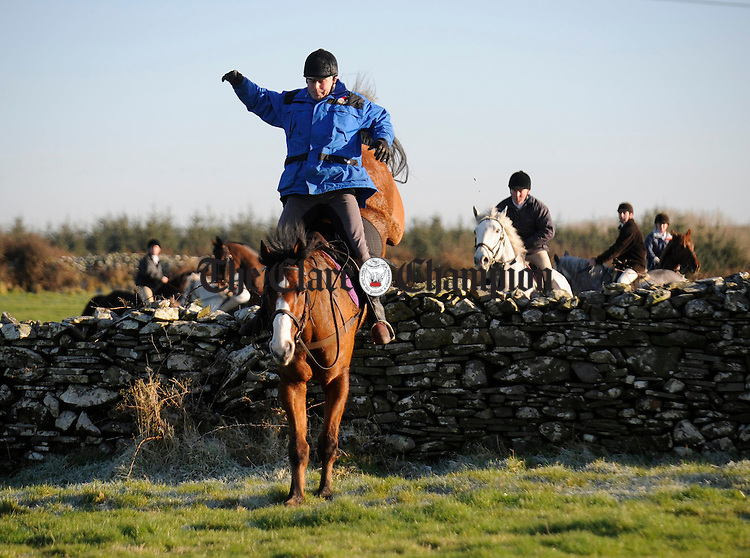 Another jump is cleared during the Clare Hunt at Kilmihil. Photograph by John Kelly.