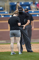 Home plate umpire Jerry Buresh has his left hand looked at after being hit by a foul tip during the NCAA baseball game between the North Carolina A&T Aggies and the North Carolina Central Eagles at Durham Athletic Park on April 10, 2021 in Durham, North Carolina. (Brian Westerholt/Four Seam Images)