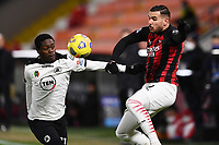 Emmanuel Gyasi of Spezia Calcio and Theo Hernandez of AC Milan compete for the ball during the Serie A football match between Spezia Calcio and AC Milan at Spezia stadium in Spezia (Italy), February 13th, 2021. Photo Image Sport / Insidefoto