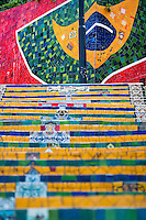 View of Selaron's Stairs (Escadaria Selarón), a colorful mosaic tile stairway, in Rio de Janeiro, Brazil, 12 February 2012. World-famous staircase, mostly covered by vibrant yellow, green and blue tiles (inspired by the colors of the Brazilian flag), is the masterpiece of Chilean-born artist Jorge Selarón who considers it as a personal tribute to the Brazilian people. Connecting the neighborhoods of Santa Teresa and Lapa, the stairway is made up of 250 steps and measures 125 meters long. In 1990 Selarón began work on the stairway, creating a constantly evolving piece of art, now adorned with over 2,000 brightly colored tiles collected from over 60 countries. Selarón funds his one man's project through donations and the sale of his black-and-red paintings which mostly depict a pregnant African woman or himself. Living his passion, the eccentric 65-year-old artist claims that this crazy and unique dream will only end on the day of my death.