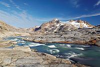 Glacial melt river and mountains, Sammileq Fjord, Ammassalik Island, East Greenland