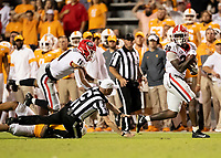 KNOXVILLE, TN - OCTOBER 5: Tae Crowder #30 of the Georgia Bulldogs runs for a touchdown after a fumble as referee is knocked down during the play during a game between University of Georgia Bulldogs and University of Tennessee Volunteers at Neyland Stadium on October 5, 2019 in Knoxville, Tennessee.