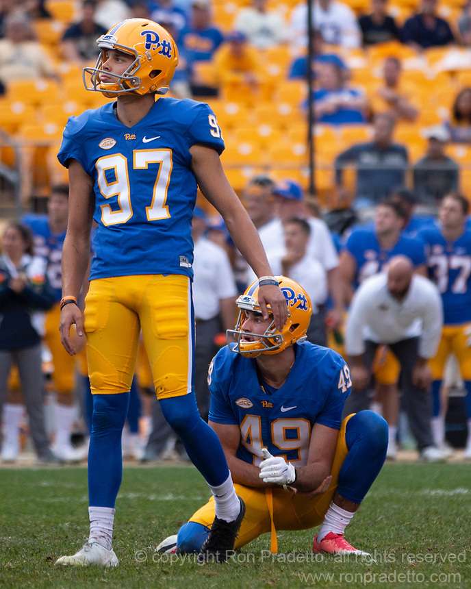 Pitt kicker Alex Kessman (97) watches his 45-yard field goal at the end of regulation. Also looking on is holder Jake Scarton (49). The Pitt Panthers defeated the Syracuse Orange 44-37 in overtime at Heinz Field in Pittsburgh, Pennsylvania on October 6, 2018.