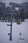 TWO SKIERS RIDE SKI LIFT AT BRECKENRIDGE COLORADO
