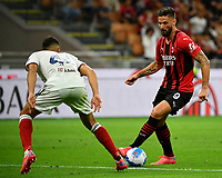 Calcio, Serie A: AC Milan - Cagliari calcio, Giuseppe Meazza (San Siro) stadium, Milan on August 29, 2021.  <br /> Milan's Olivier Giroud (r) in action with Cagliari's Andrea Carboni (l) during the Italian Serie A football match between Milan and Cagliari at Giuseppe Meazza stadium, on August 29, 2021.  <br /> UPDATE IMAGES PRESS/Isabella Bonotto