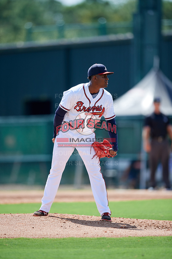 GCL Braves relief pitcher Alex Aquino (30) looks in for the sign during the first game of a doubleheader against the GCL Yankees West on July 30, 2018 at Champion Stadium in Kissimmee, Florida.  GCL Yankees West defeated GCL Braves 7-5.  (Mike Janes/Four Seam Images)