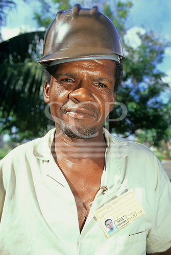 Bahia State, Brazil. Black man in a safety hat.