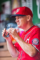 22 June 2014: Washington Nationals Manager Matt Williams dons sunglasses in the dugout prior to a game against the Atlanta Braves at Nationals Park in Washington, DC. The Nationals defeated the Braves 4-1 to split their 4-game series and take sole possession of first place in the NL East. Mandatory Credit: Ed Wolfstein Photo *** RAW (NEF) Image File Available ***