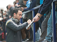 Picture by Steve Flynn/AHPIX.com, Football: The FA Cup 3rd Round match Tranmere Rovers -V- Swansea City  at Prenton Park, Birkenhead, Merseyside, England on copyright picture Howard Roe 07973 739229<br /> <br /> <br /> Swansea City's Leon Britton signs autographs before the game