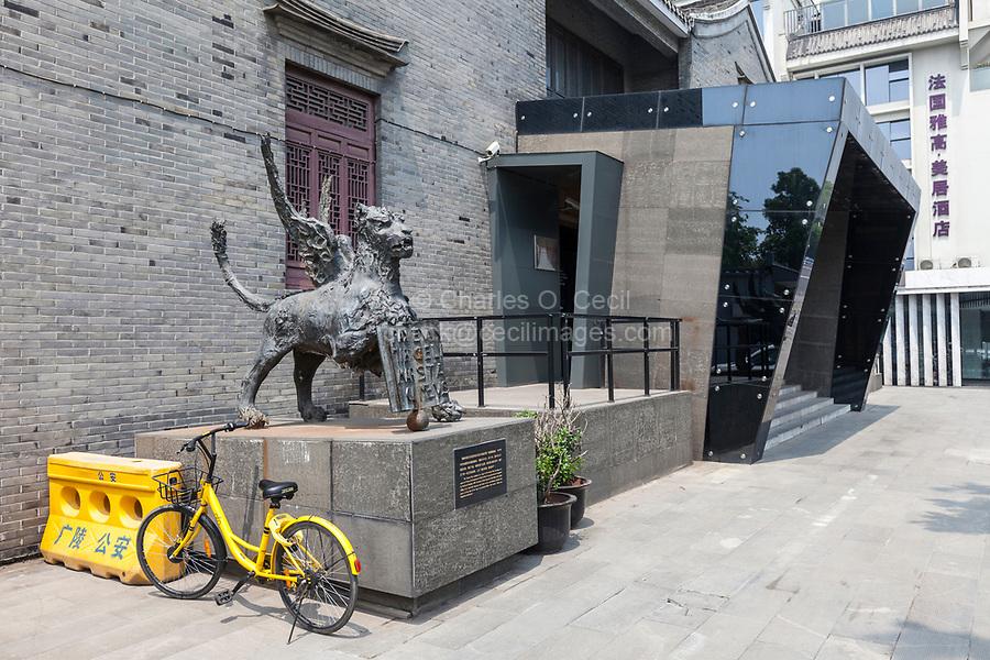 Yangzhou, Jiangsu, China.  Marco Polo Memorial Hall.  The lion sculpture is a replica of a similar piece in Venice, home of marco Polo.