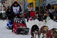 2010 Iditarod Ceremonial Start in Anchorage Alaska musher # 4 WATTIE McDONALD with Iditarider JULIA ROLES