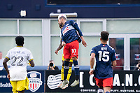 FOXBOROUGH, MA - MAY 16: Teal Bunbury #10 of New England Revolution and Waylon Francis #14 Columbus SC compete for a head ball during a game between Columbus SC and New England Revolution at Gillette Stadium on May 16, 2021 in Foxborough, Massachusetts.