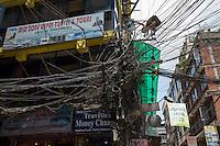 Nepal, Kathmandu. Patan Durbar Square, earthquake damage. Electrical lines in Kathmandu