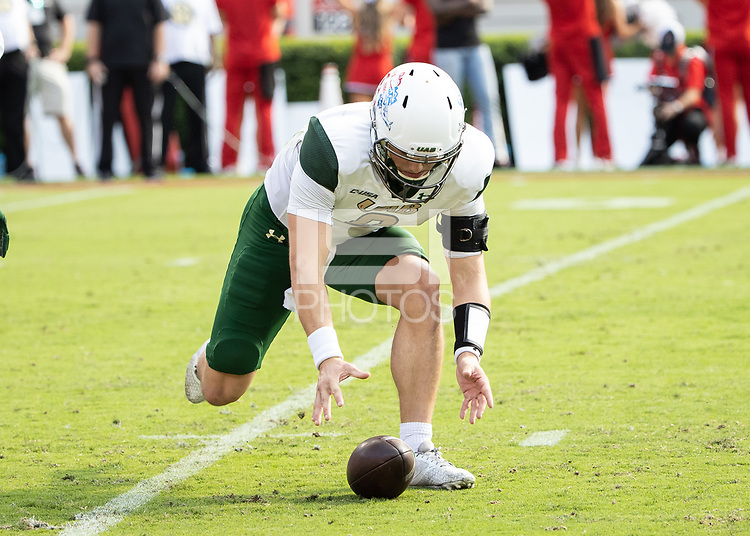 ATHENS, GA - SEPTEMBER 11: Dylan Hopkins #9 attempts to pick up his fumbled snap during a game between University of Alabama Birmingham Blazers and University of Georgia Bulldogs at Sanford Stadium on September 11, 2021 in Athens, Georgia.