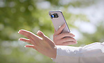 Pictured: Scientists have created a digital sanitiser which uses a smartphone's torch to clean hands.   The UVLEN uses a hi-tech ultraviolet light to rid surfaces of bacteria and germs in 10 seconds.<br /> <br /> And, its creators say the portable and lightweight device can even protect against Covid-19.   Developers UVLEN say their product - which costs $25 (£19) - can work with any smartphone and all users have to do is attach it to their phone's torch. SEE OUR COPY FOR DETAILS<br /> <br /> Please byline: UVLEN/Solent News<br /> <br /> © UVLEN/Solent News & Photo Agency<br /> UK +44 (0) 2380 458800