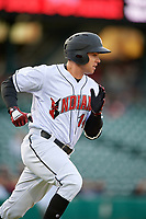 Indianapolis Indians third baseman Eric Wood (14) runs to first base during a game against the Toledo Mud Hens on May 2, 2017 at Victory Field in Indianapolis, Indiana.  Indianapolis defeated Toledo 9-2.  (Mike Janes/Four Seam Images)