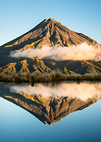 Sunset over Mount Taranaki volcano, Egmont National Park, North Island, New Zealand, NZ