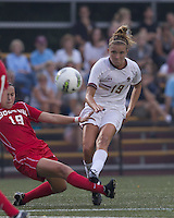Boston College midfielder Kristen Mewis (19) passes the ball as Boston University defender Kai Miller (19) defends. After 2 complete overtime periods, Boston College tied Boston University, 1-1, after 2 overtime periods at Newton Soccer Field, August 19, 2011.