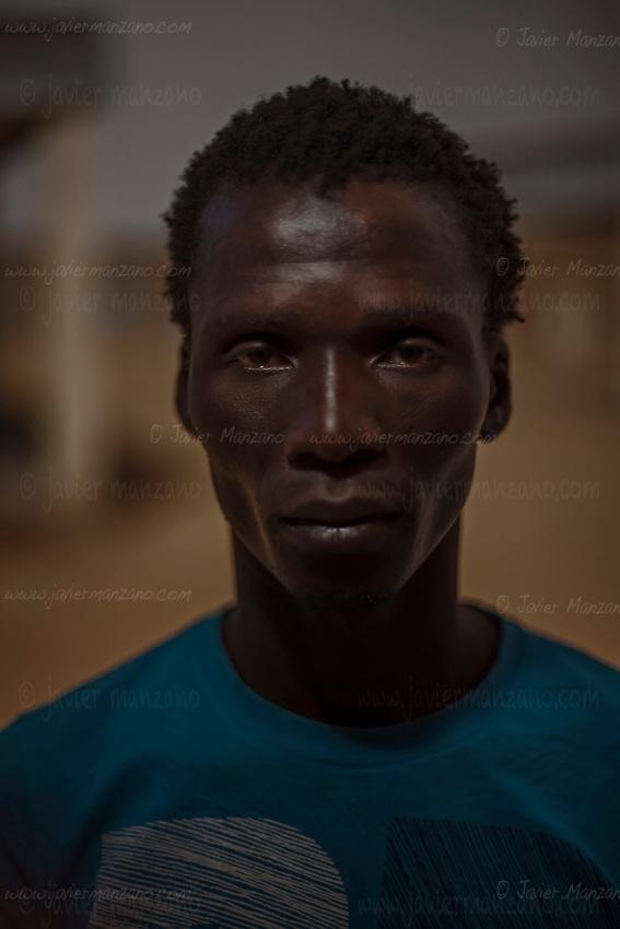 """AGADEZ, NIGER — <br /> <br /> 23-year-old Silvé Namongo from Ivory coast reached Tripoli, Libya on May of 2015. He made several attempts to find a job in Tripoli but mentioned that he was mistreated by the locals. """"They don't like the black man there"""". He was deported from Tripoli a month later and arrived in Agadez on June 28, 2015. It took him almost three years to save the $1,000 dollars it cost him to reach Libya. """"You can't eat in Ivory Coast being a tailor"""" he concluded."""