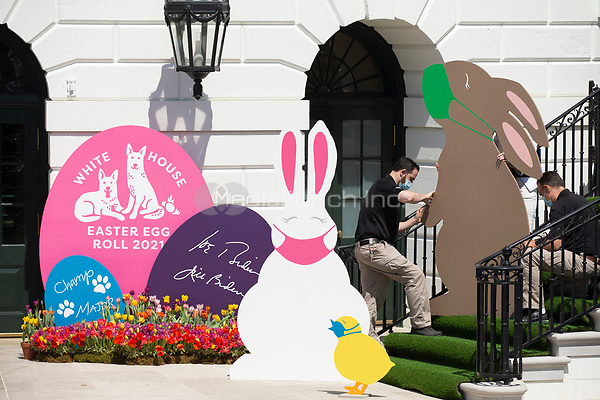 Decorations depicting Easter bunnies and chicks wearing face masks are seen at the South Portico steps of the White House before US President Joe Biden (not pictured) delivered remarks regarding Easter, in Washington, DC, USA, 05 April 2021. The traditional Easter Egg Roll at the White House with thousands of visitors was not held due to the coronavirus COVID-19 pandemic.<br /> Credit: Michael Reynolds / Pool via CNP /MediaPunch