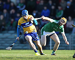 Shane O Donnell of  Clare  in action against Richie English of  Limerick during their NHL quarter final at the Gaelic Grounds. Photograph by John Kelly.