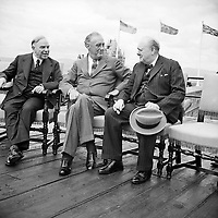 Canadian Prime Minister Mackenzie King, with President Franklin D Roosevelt, and Winston Churchill during the Quebec Conference, 18 August 1943. Canadian Prime Minister Mackenzie King, President of the United States of America Franklin D Roosevelt, and British Prime Minister Winston Churchill in conversation during the Quebec conference on 18 August 1943.