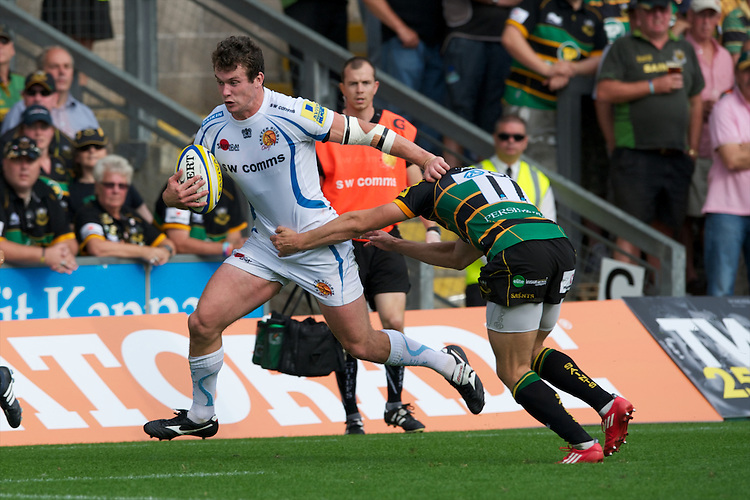 Ian Whitten of Exeter Chiefs outruns Vasily Artemyev of Northampton Saints during the Aviva Premiership match between Northampton Saints and Exeter Chiefs at Franklin's Gardens on Sunday 9th September 2012 (Photo by Rob Munro)