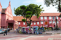 Stadthuys, Former Dutch Governor's Residence and Town Hall, Built 1650.  Christ Church, built 1753, on left.  Trishaws for tourists in foreground.  Melaka, Malaysia.