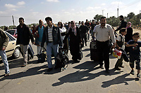 """Palestinians wait to cross the main border crossing between the Gaza Strip and Egypt May 10, 2008. The main border crossing between the Hamas-controlled Gaza Strip and Egypt was temporarily opened on Saturday under a deal between the Islamist group and Cairo, Palestinian officials said""""photo by Fady Adwan"""""""