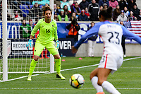 Harrison, NJ - Sunday March 04, 2018: Sarah Bouhaddi, Christen Press during a 2018 SheBelieves Cup match match between the women's national teams of the United States (USA) and France (FRA) at Red Bull Arena.