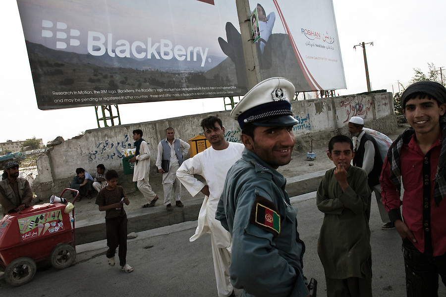 Modernity and tradition clash in the streets of Kabul nears the city's international airport. June 2010.