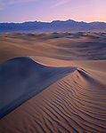 Death Valley National Park; CA<br /> Soft dawn light on sand &  pattern of the Mesquite Flat Dunes