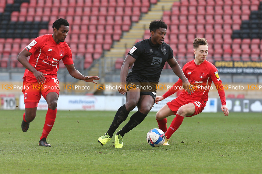 Devante Rodney of Port Vale evades Tunji Akinola of Leyton Orient during Leyton Orient vs Port Vale, Sky Bet EFL League 2 Football at The Breyer Group Stadium on 20th February 2021