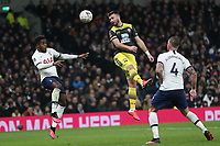 Shane Long of Southampton gets in a header ahead of Ryan Sessegnon of Tottenham Hotspur whilst Toby Alderweireld of Tottenham Hotspur watches during Tottenham Hotspur vs Southampton, Emirates FA Cup Football at Tottenham Hotspur Stadium on 5th February 2020