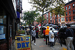 BROOKLYN, NY — OCTOBER 27, 2020:  People wait in line to vote around the corner from the Park Slope Armory during early voting for the 2020 U.S. presidential election on October 27, 2020 in the Brooklyn borough of New York City.  Photograph by Michael Nagle
