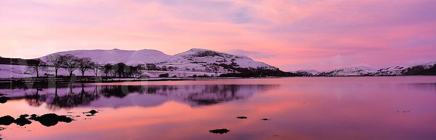 © David Paterson.Warm evening sky reflected in calm water in snow-covered landscape. Loch Fleet (Dornoch Firth), NE Scotland, with the Cambusmore Hills...Keywords: hills, range, lake, loch, evening, sunset, dusk, peace, quiet, tranquil, winter, cold, snow, Fleet, Golspie, Sutherland, Scotland, Highlands
