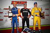 Will Power, Team Penske Chevrolet, Scott Dixon, Chip Ganassi Racing Honda, Simon Pagenaud, Team Penske Chevrolet receive their trophies in victory lane