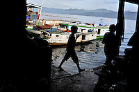 Ferries at Ambon's main port which cross from the mainly Christian Ambon City area to the geographically larger, Muslim-dominated, part of the island (in distance).  The 1999-2002 religious war between Maluku's Christian and Muslim populations, mainly centred on Ambon Island, led to over 5000 deaths and to around 500,000 people become displaced. Destroyed homes and offices, churches and mosques are slowly being either torn-down or renovated.  Urban centres, such as Ambon City, continue to be split along largely sectarian lines, and tensions are never far below the surface. Riots between Christian and Muslim youths erupted in September 2011 and, most recently, June 2012, though luckily simmered down just as quickly, partly due to community leaders learning how to defuse tensions from the earlier, more devastating, conflagration. /Felix Features