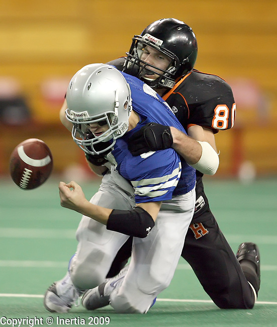 VERMILLION, SD - NOVEMBER 13: Zach Torkelson #80 of Howard forces a fumble from Justin Grosdidier #8 of Emery-Ethan in the fourth quarter of the South Dakota Class 9AA Championship game Friday, Nov. 13, 2009 at the DakotaDome in Vermillion, South Dakota. (Photo by Dave Eggen/Inertia)
