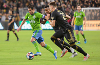 LOS ANGELES, CA - OCTOBER 29: Nicolas Lodeiro #10 of Seattle Sounders FC moves past Mark-Anthony Kaye #14 of Los Angeles FC during a game between Seattle Sounders FC and Los Angeles FC at Banc of California Stadium on October 29, 2019 in Los Angeles, California.