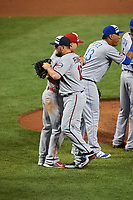 Minnesota Twins Brian Dozier hugs Los Angeles Angels Mike Trout after closing out the MLB All-Star Game on July 14, 2015 at Great American Ball Park in Cincinnati, Ohio.  (Mike Janes/Four Seam Images)