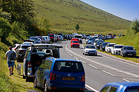 Pictured: Cars parked on the grass verge on either side of the A470 near Storey Arms in the Brecon Beacons, Wales, UK. Sunday 13 June 2021<br /> Re: High temperatures and sunshine has been forecast for most of the UK.