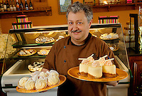 Small business photography of Concord NC's Chocolatier Barrucand shop at 1 Union Street in downtown Concord, North Carolina. Owner Jean Luc Barrucand  proudly displays a few of the delicious chocolates and sweets sold at the store. The small business is run by spouses Ann Marie and Jean Luc Barrucand. Photo is part of a photographic series of images featuring Concord, NC, by Charlotte-based photographer Patrick Schneider.